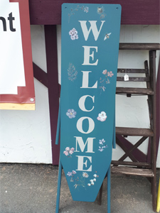 welcome sign and table